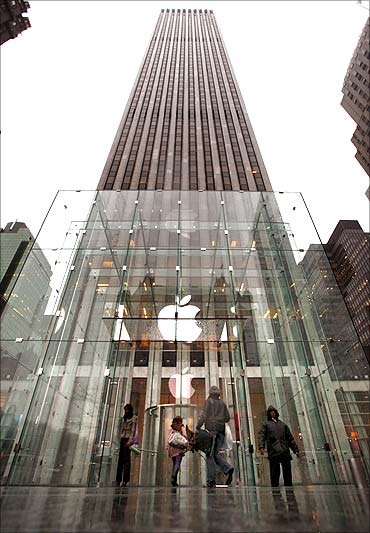 Customers enter the Fifth Avenue Apple store in New York.