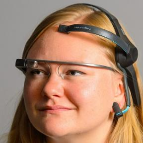 a lady wearing google glass