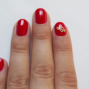 An easier alternative to free-hand nail art: Hex's gold-plated nail charms start at $1.50 each.