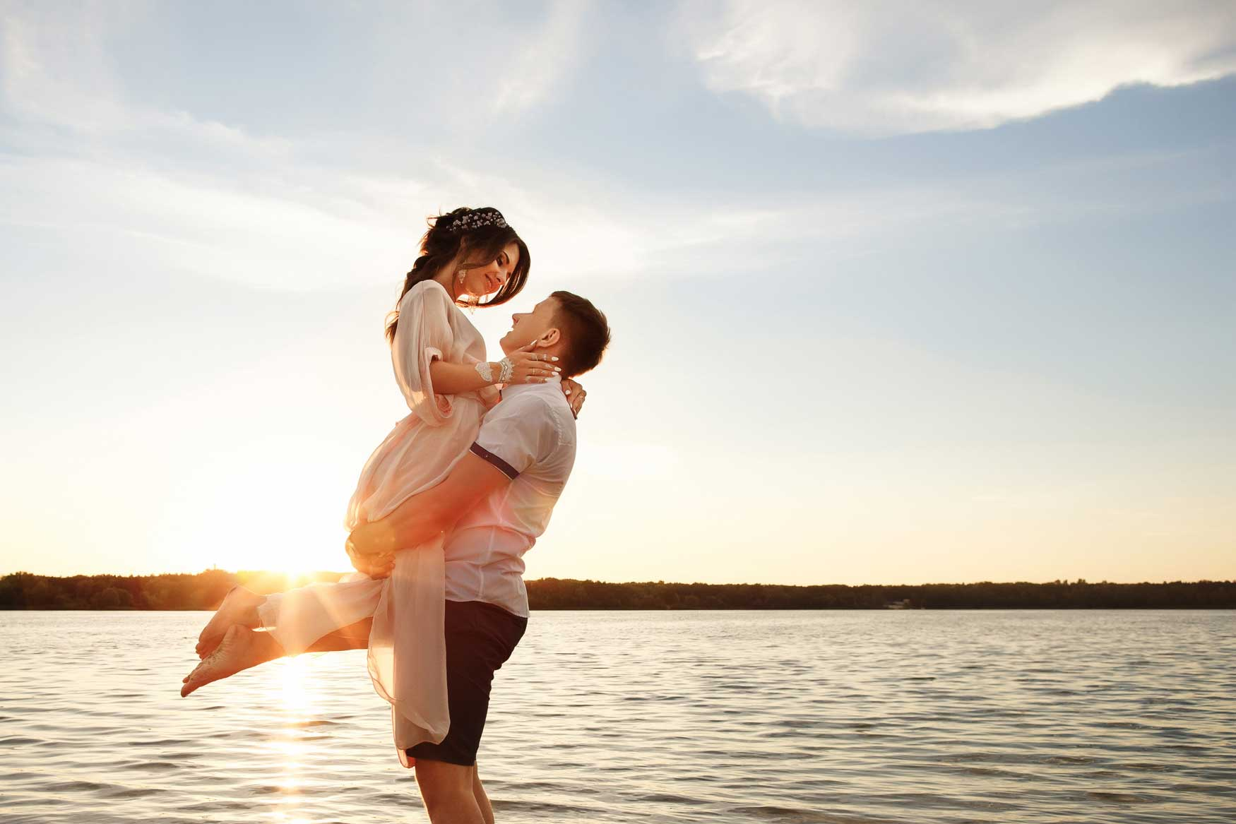 best-honeymoon-destinations-in-the-world-newlyweds-happy-together-at-the-beach-sunset