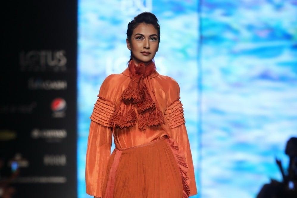 A Model Walks The Ramp Showcasing Fashion Designer Nidhi Yasha S Creations On The First Day Of Lotus Make Up India Fashion Week Savedelete