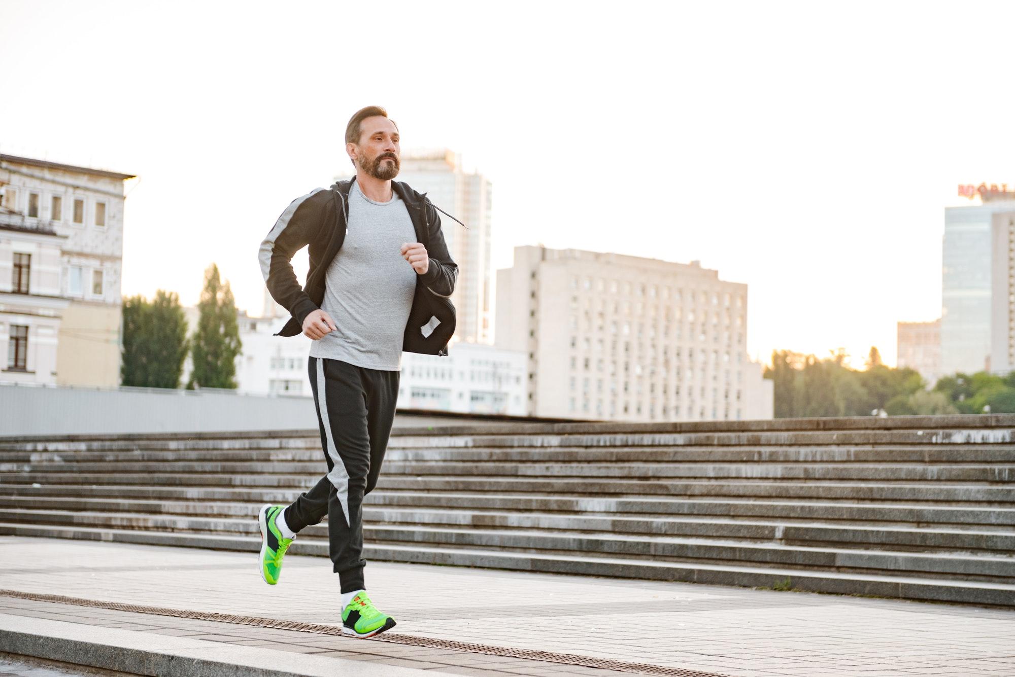 Motivated sportsman running outdoors