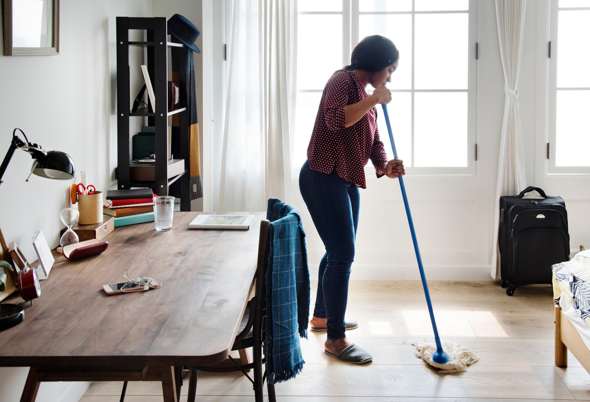 Black woman cleaning room