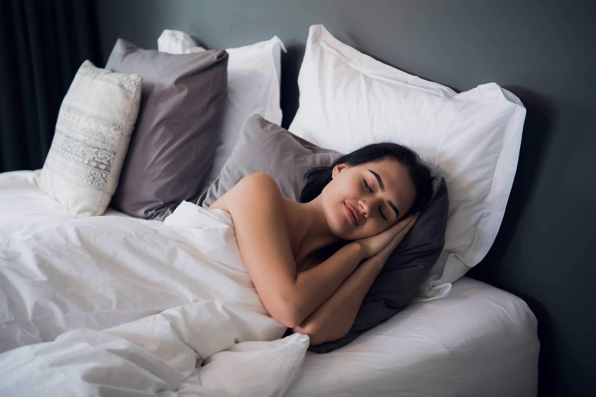 Good dreams make your day better. Attractive young woman sleeping joyfully