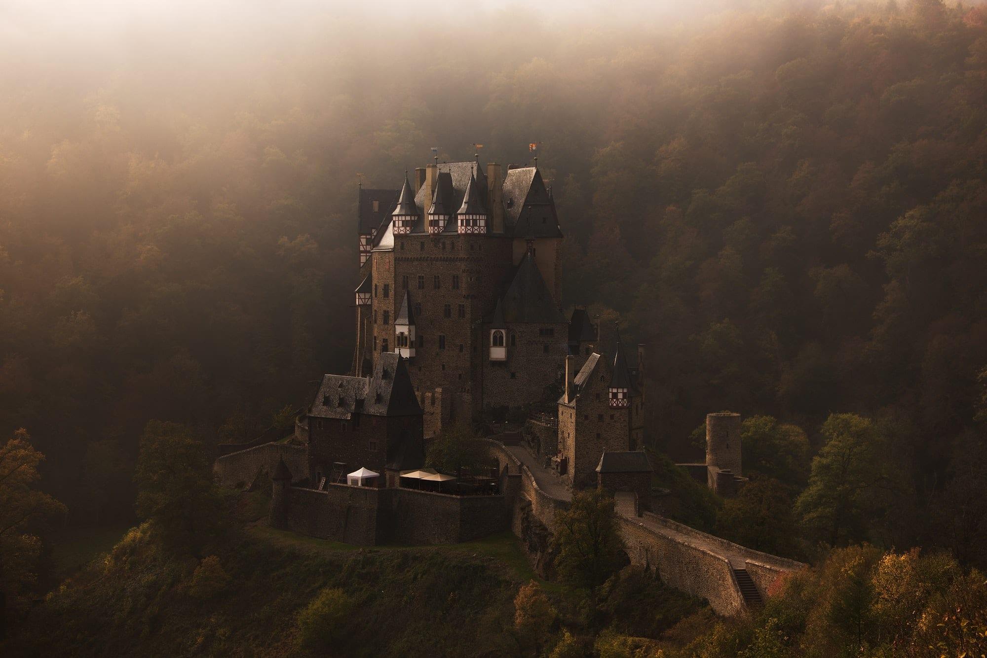 Burg Eltz castle in the early morning fog