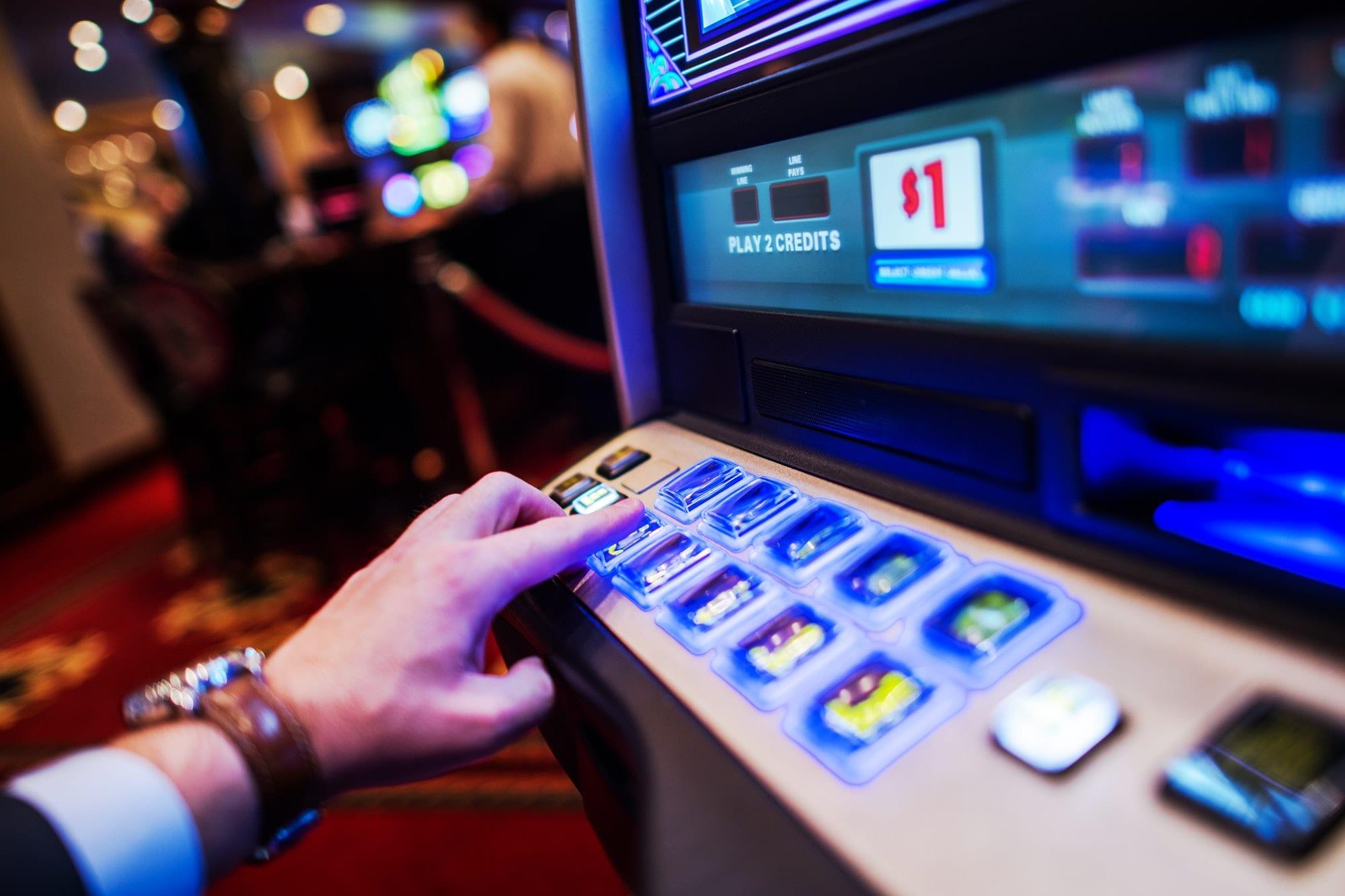 Men Playing Slot Machine