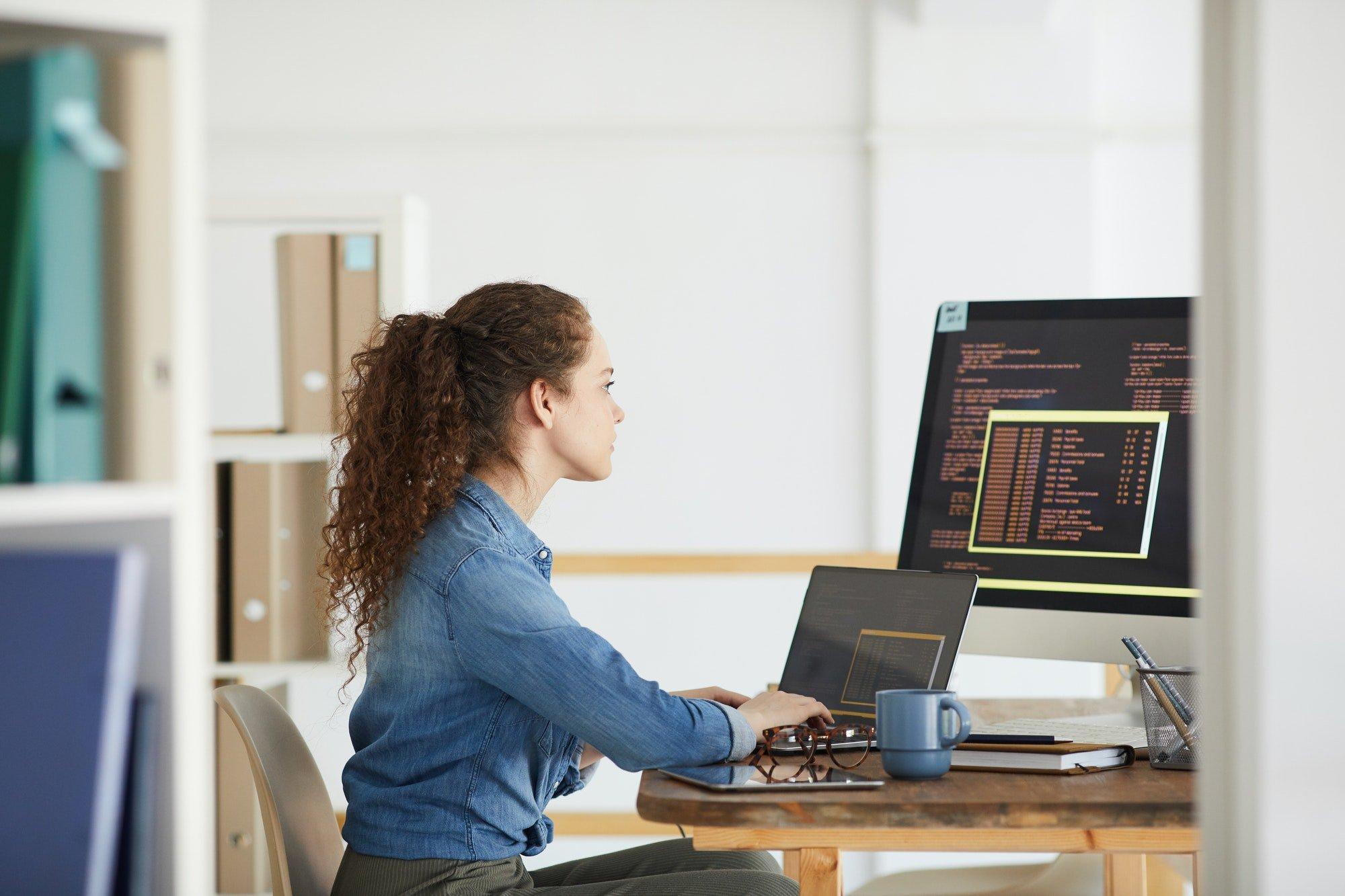 Young Woman Working in Software Development Studio