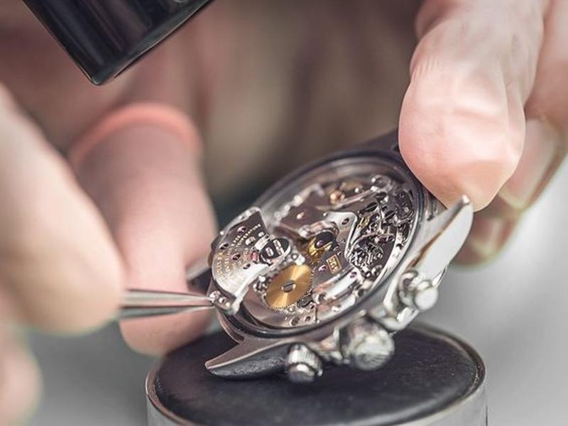 A Watchmaker Servicing a Watch