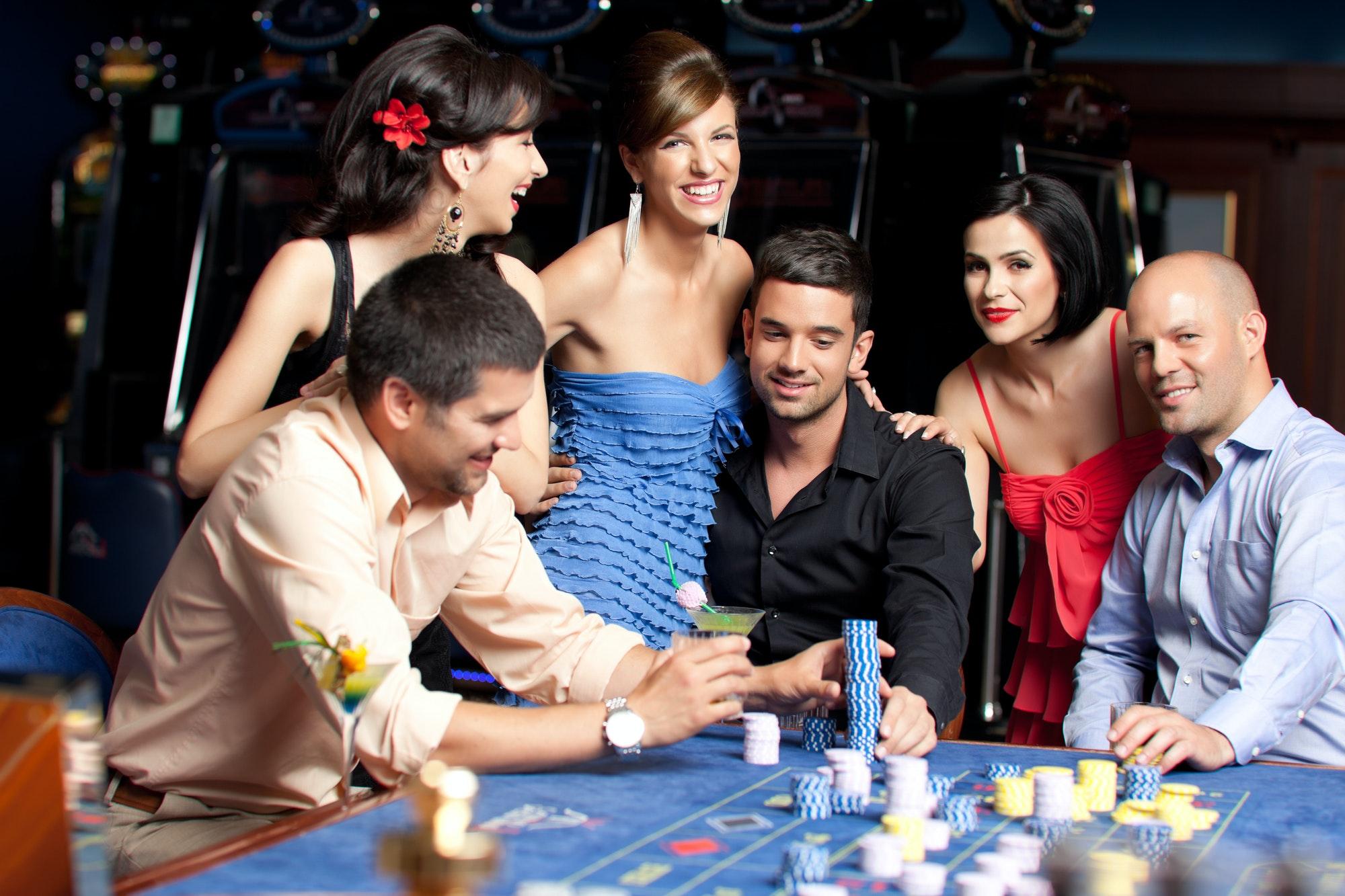 young beautiful people having fun at the casino