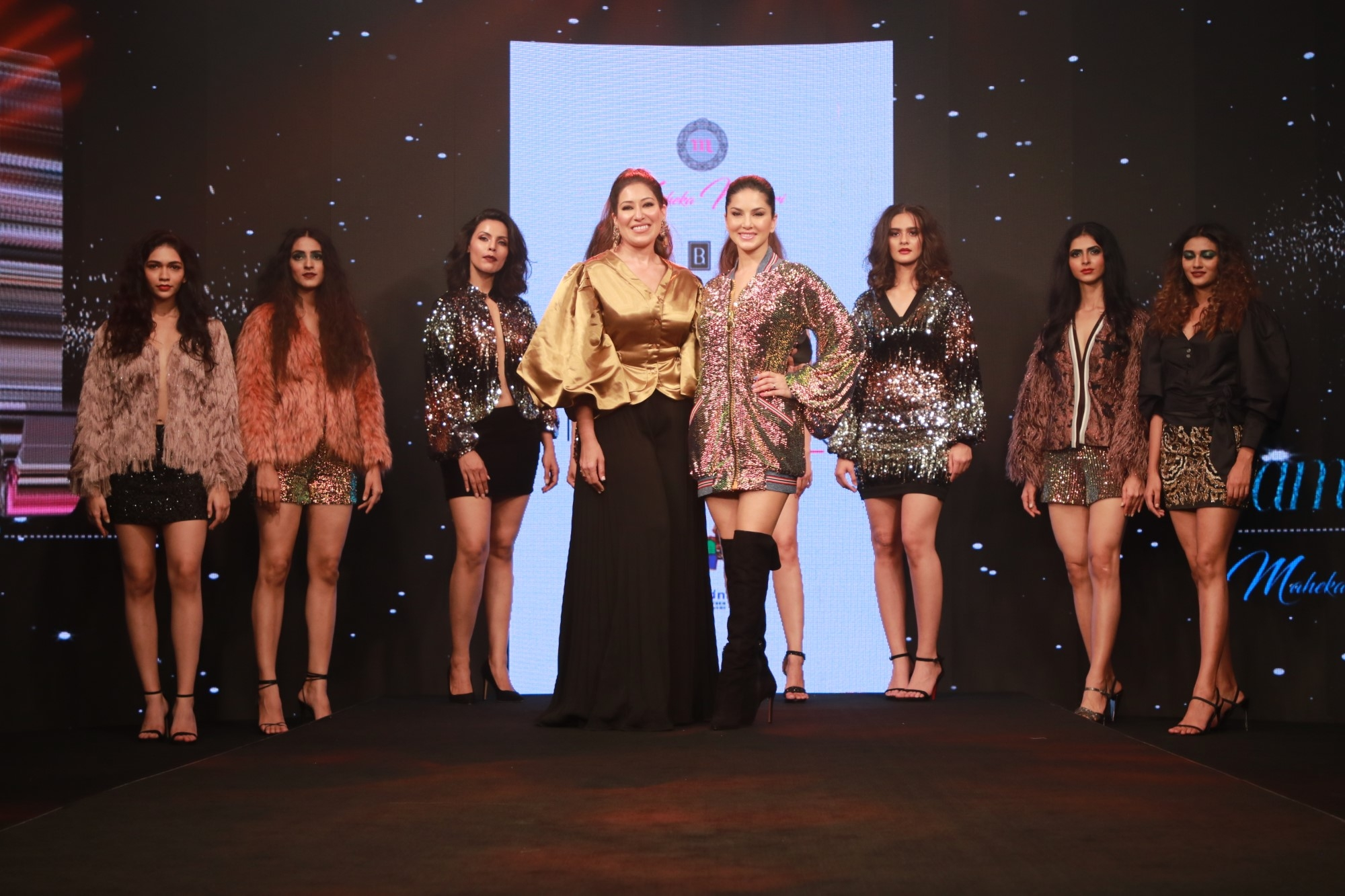 Actress Sunny Leone shares the ramp with fashion designer Maheka Mirpuri during the latter's show on Day 3 of the Bombay Times Fashion Week, in Mumbai