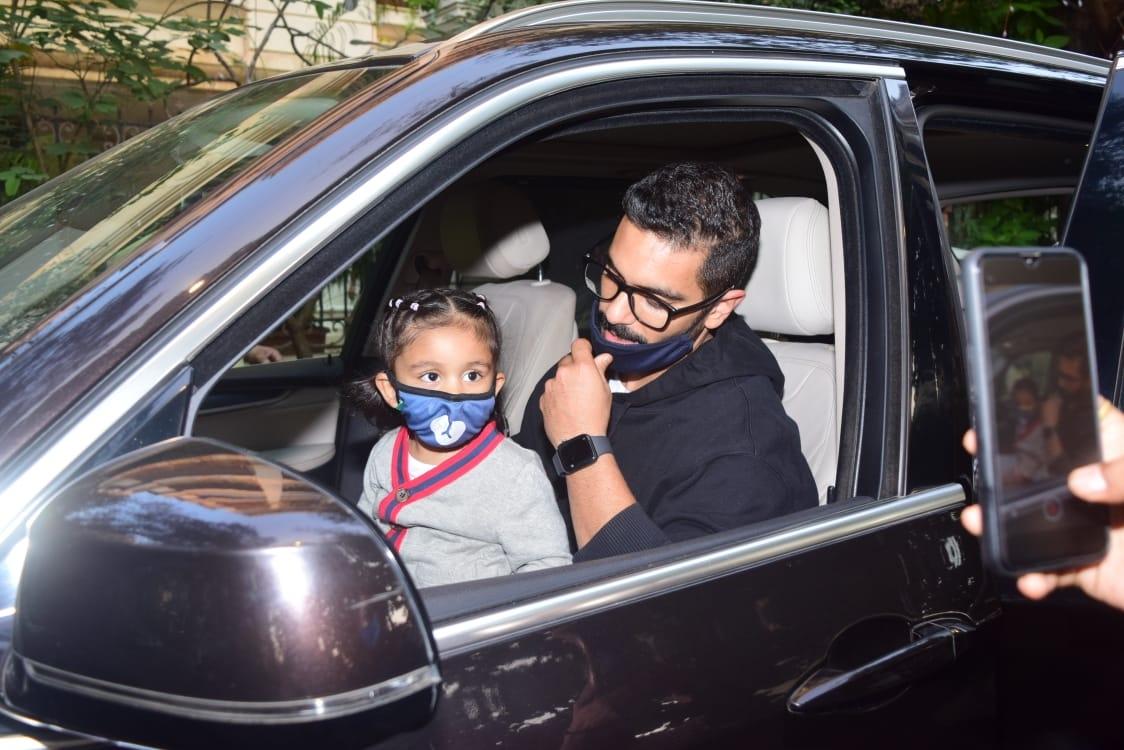 Actor Angad Bedi and his daughter Mehr Dhupia Bedi seen at Mumbai's Bandra