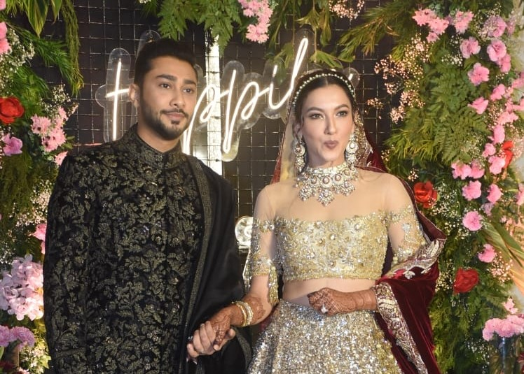 Bollywood music composer Ismail Darbar's son Zaid Darbar and actress Gauahar Khan at their wedding reception, in Mumbai