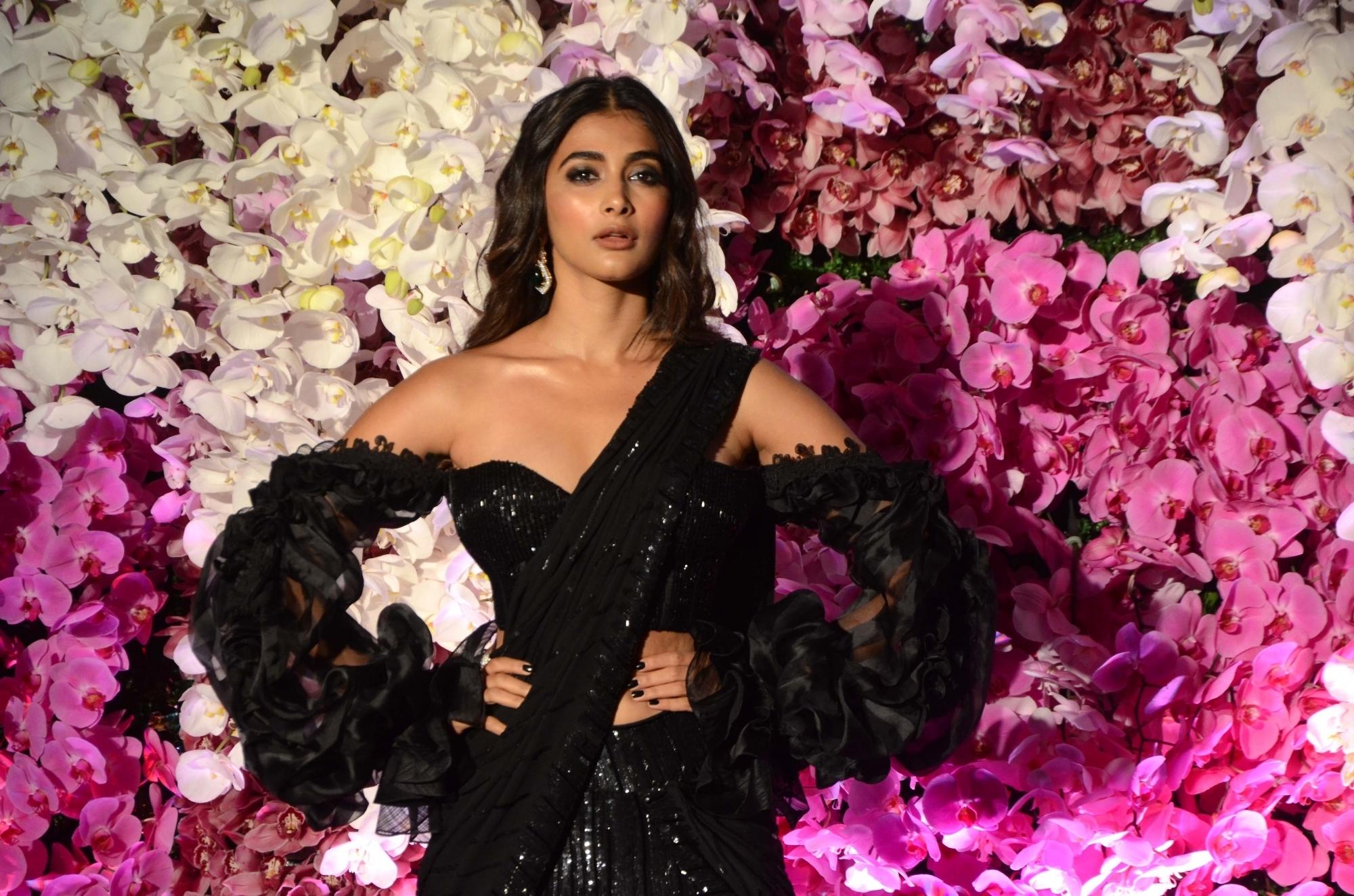 Actress Pooja Hegde at the wedding reception of Akash Ambani and Shloka Mehta in Mumbai