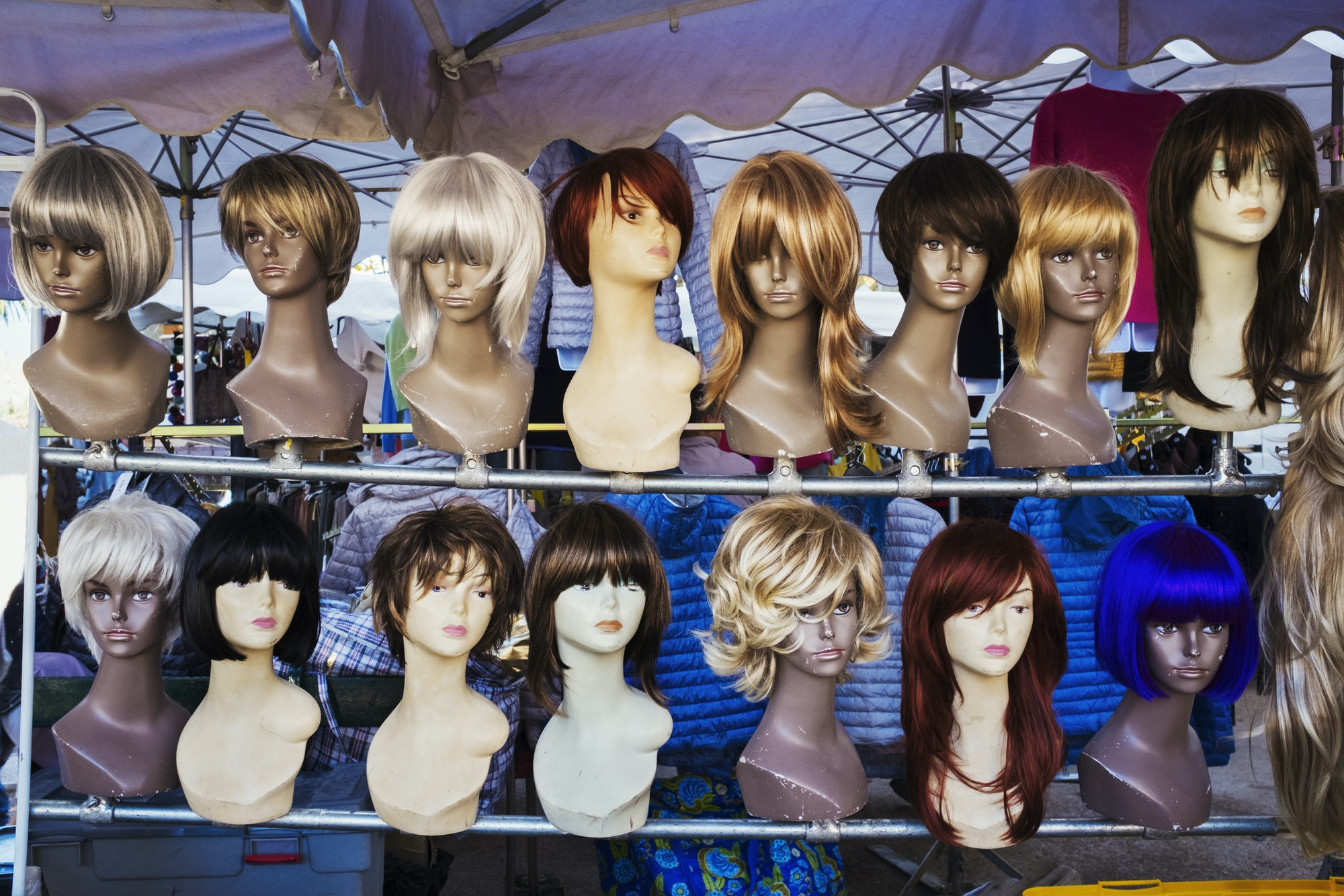 A wig stall, female mannequin heads and display of wigs.