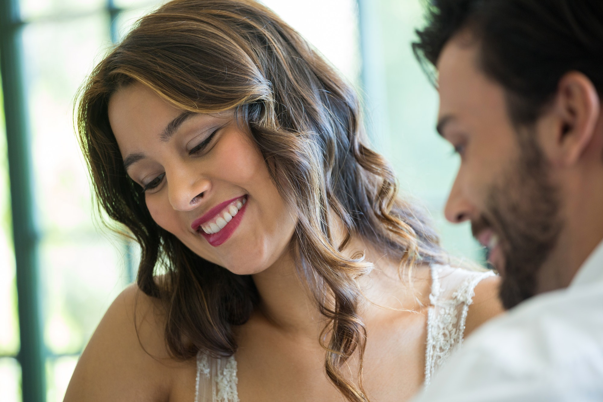 Smiling woman dating with man in restaurant