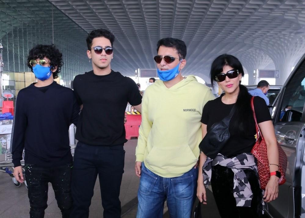 Filmmaker Sajid Nadiadwala seen with his wife Wardha Khan and sons Subhan Nadiadwala and Sufyan Nadiadwala seen at the Chhatrapati Shivaji Maharaj International Airport in Mumbai