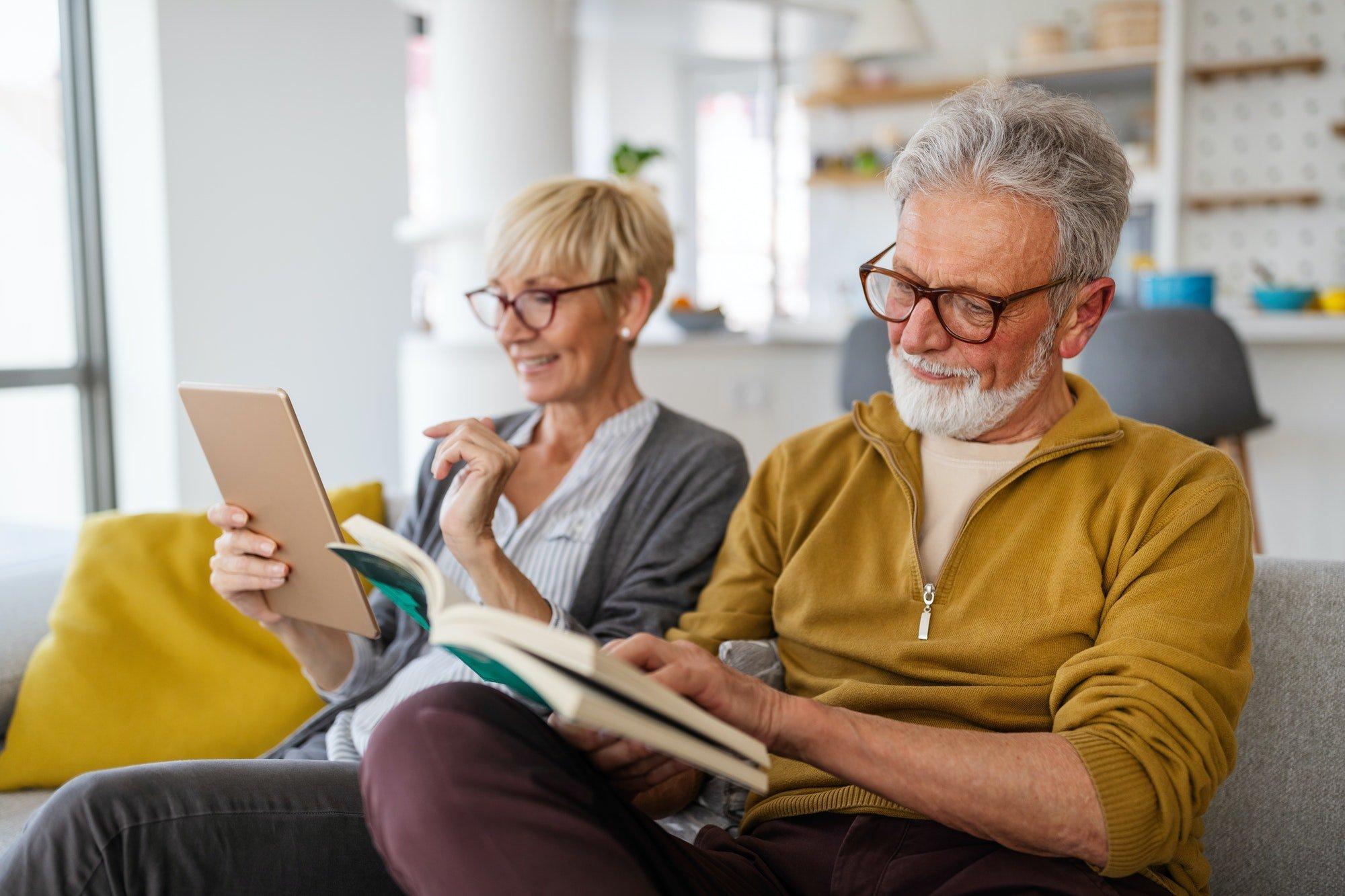 Cheerful senior couple enjoying retired life at home