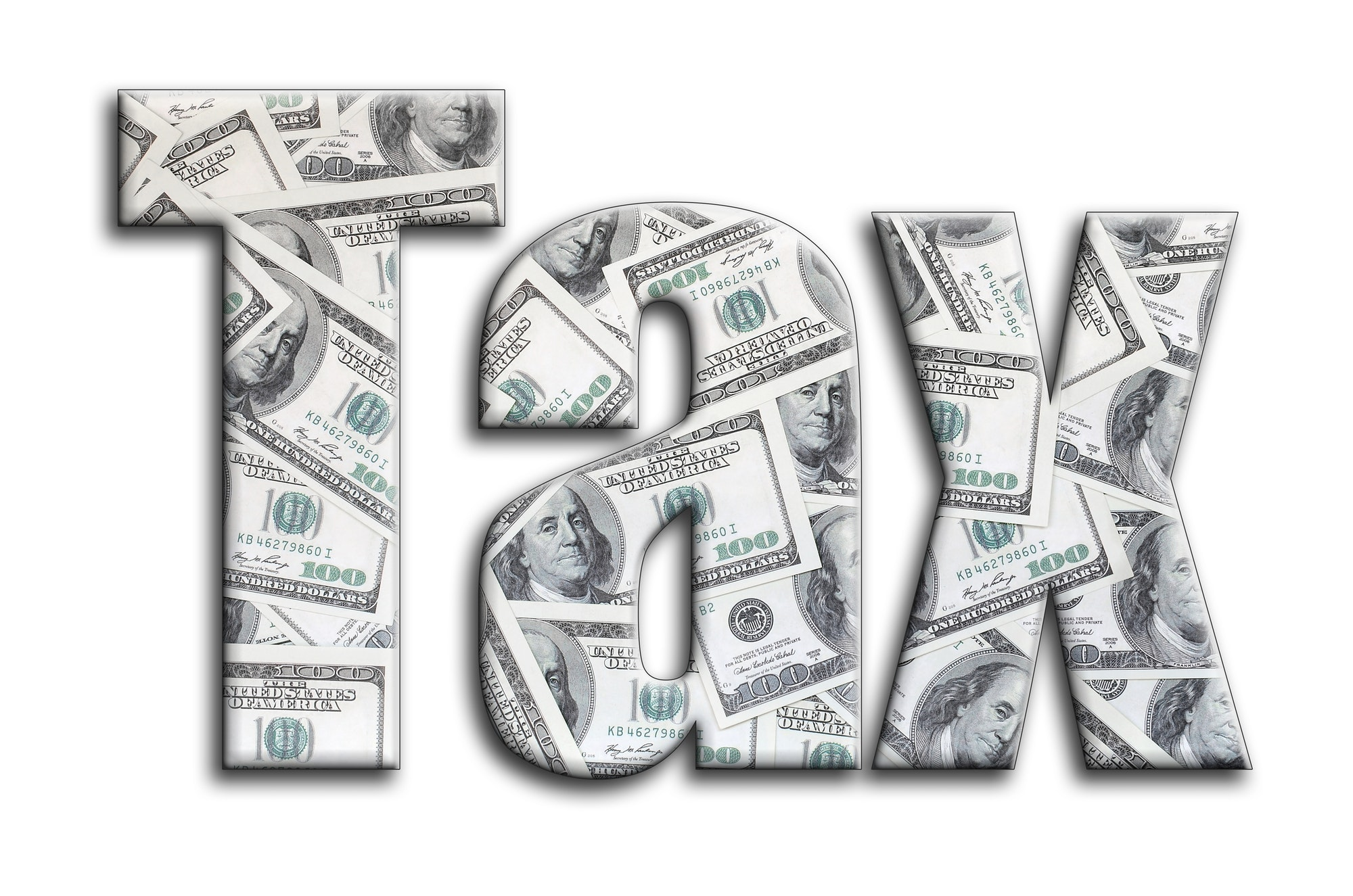Tax. The inscription has a texture of the photography, which depicts a lot of US dollar bills.