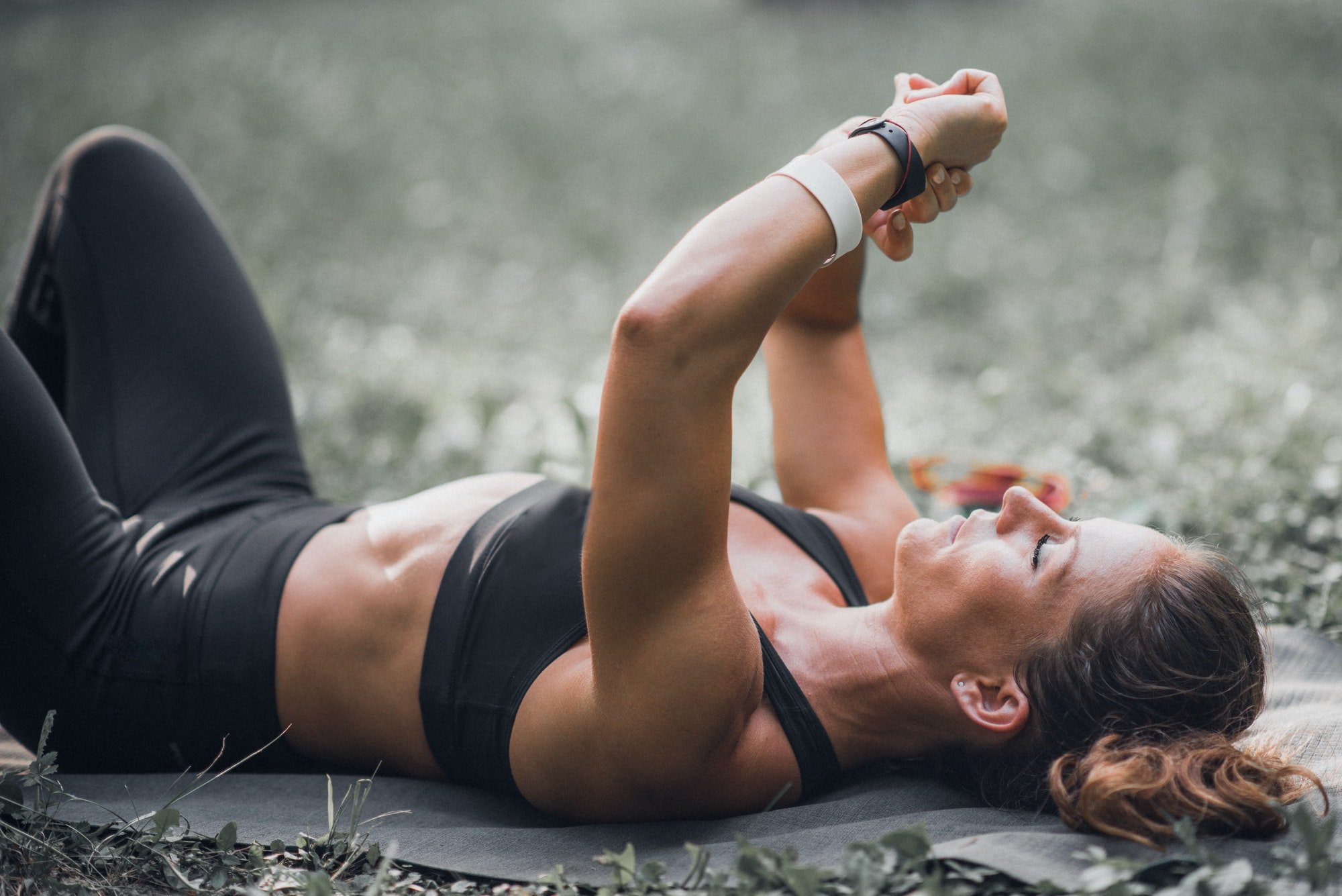 Woman looking smart watch after training outdoors