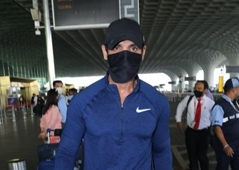 John Abraham Spotted at Airport Departure