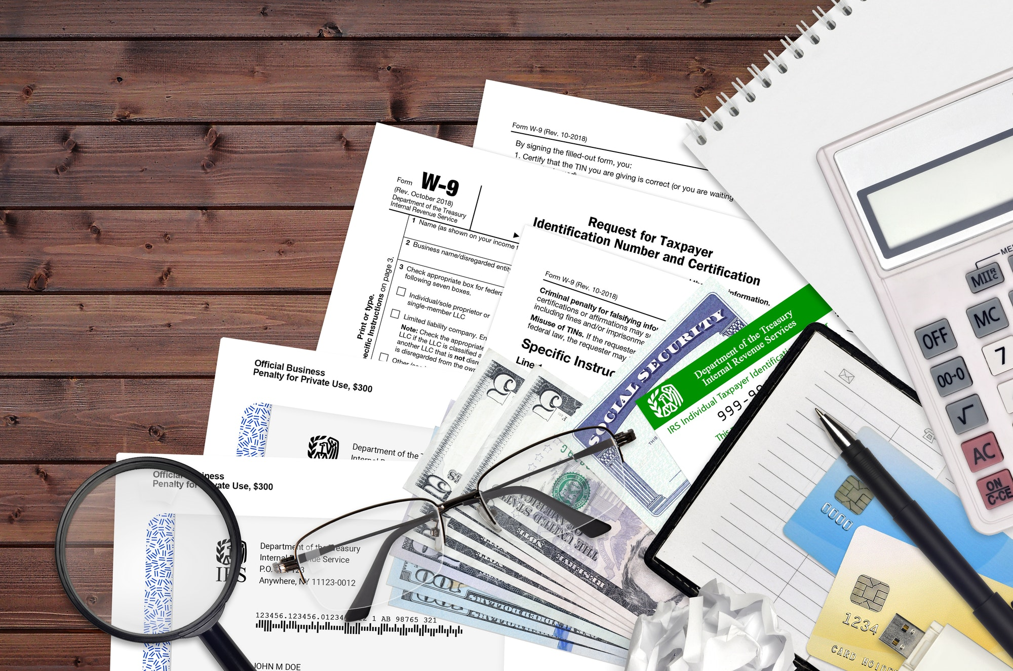 IRS form W-9 Request for taxpayer identification number and certification lies on flat lay office