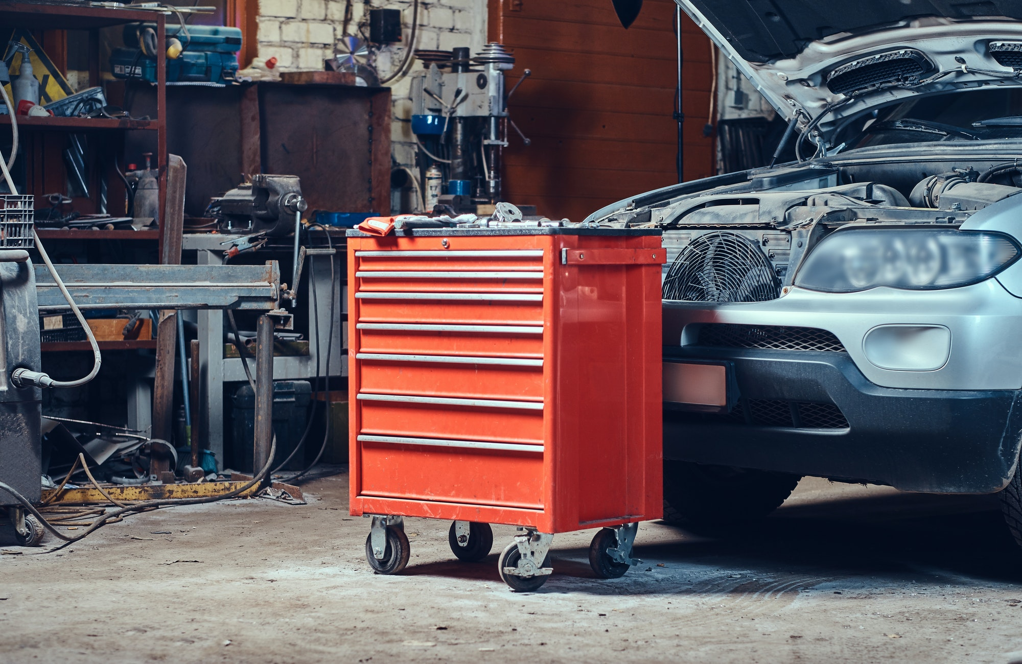 Red tool box in a garage.