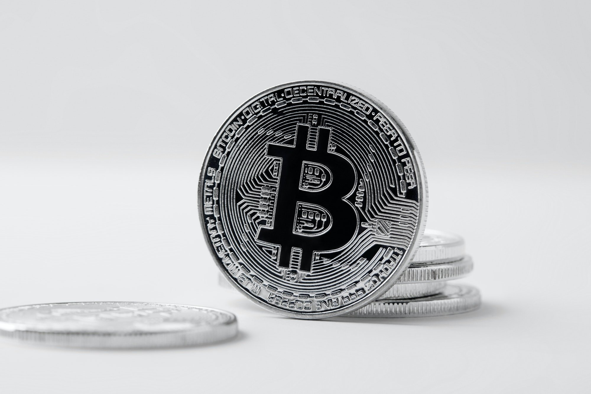 close-up shot of bitcoin standing on white surface