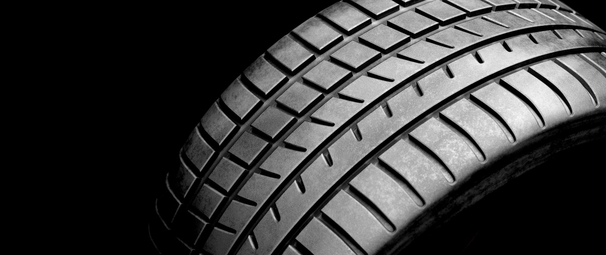 New wheel tire close-up on black
