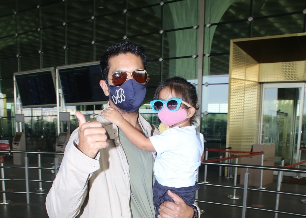 Angad bedi and his daughter spotted at airport departure