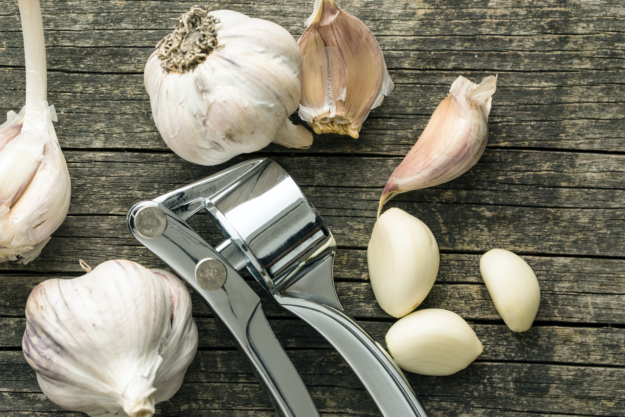 Garlic and garlic press.