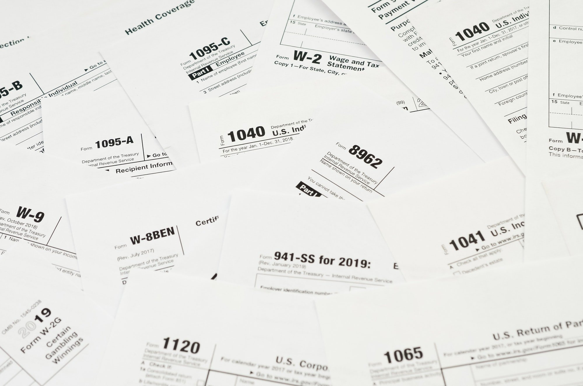 Many tax form blanks lies on table close up