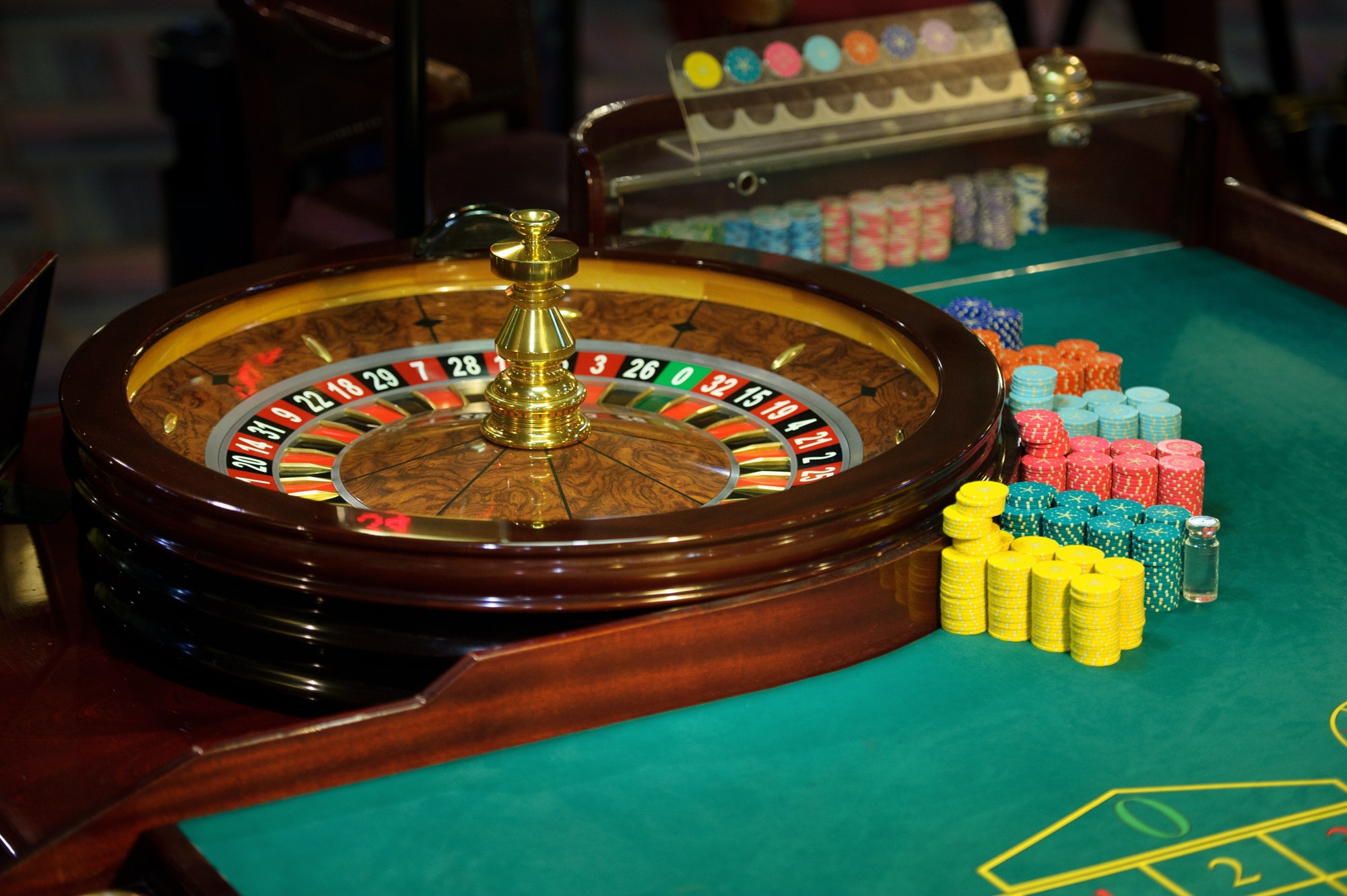 roulette and the green table with chips in the casino