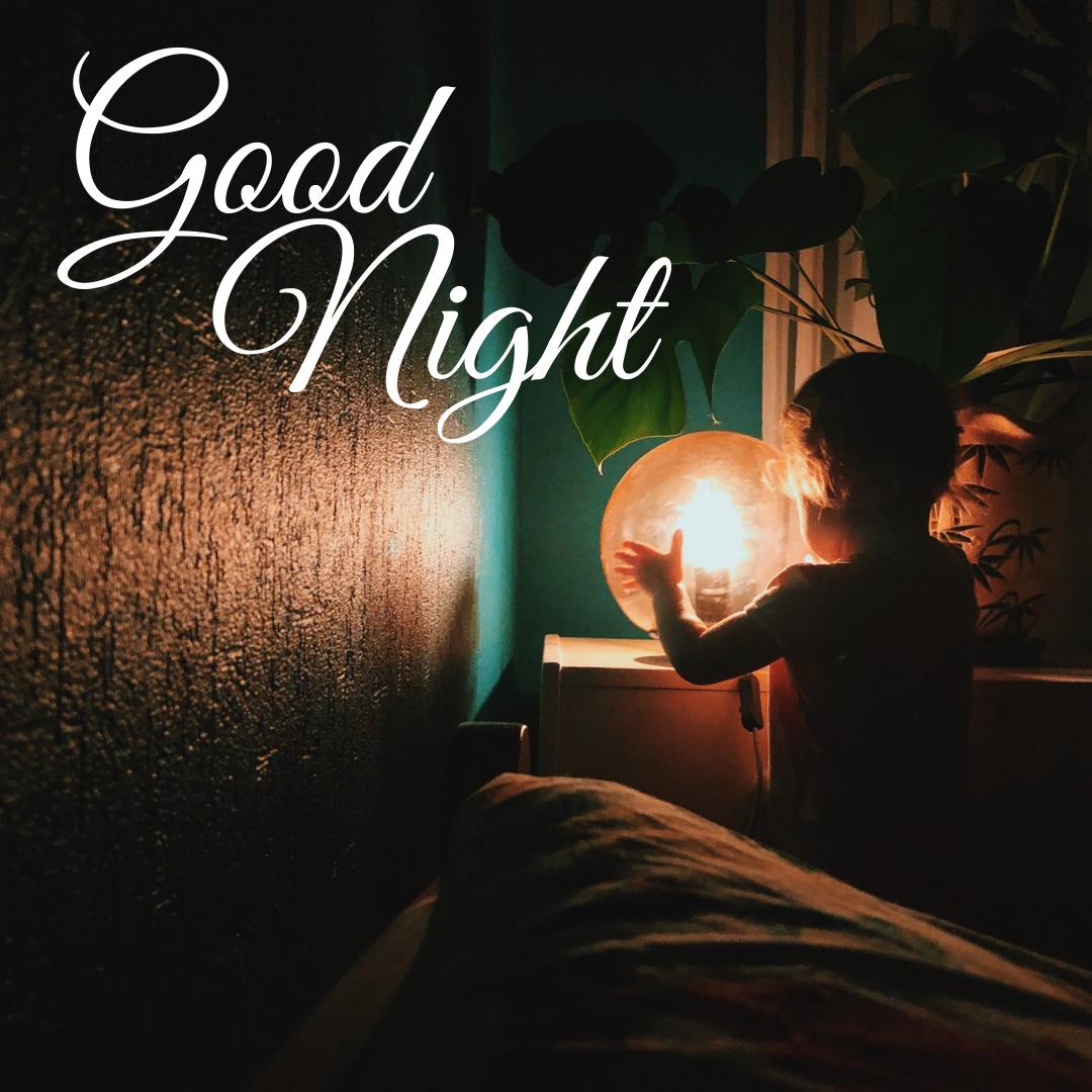 Good Night...Little boy looking At Lamp